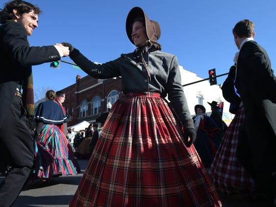 Flat Creek Dancers, Berea Festival Dancers and festivalgoers dance together during the 32nd annual Dickens of a Christmas in downtown Franklin on Saturday, Dec. 10, 2016.