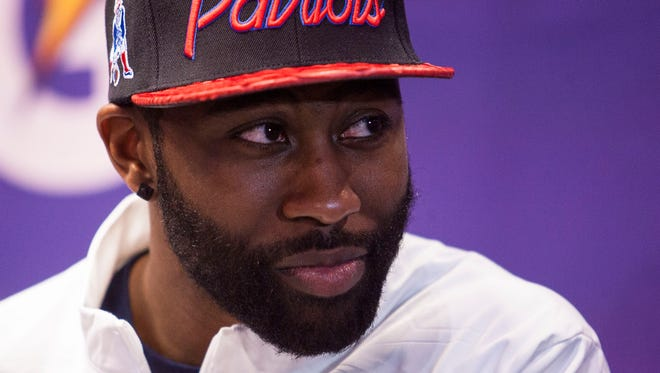 Darrelle Revis of the New England Patriots answers questions for the media at the Super Bowl Media Day held at US Airways Center on Jan. 27, 2015, in Phoenix.