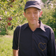 "Chris Dorman, who plays the titular role on ""Mister Chris and Friends,"" a new children's show on Vermont PBS, stands in an apple orchard, part of his missions to show children the beauty of the world."