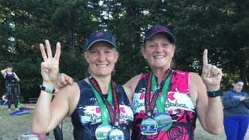 Lisa Ballou, left, and Suzie Simms pose for a photo after completing the 2016 Pacific Crest Half Ironman Distance Triathlon in Sun River Oregon. The pair, while on opposite ends of the political spectrum, say they don't let the differences come between them.