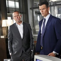 """In this image released by CBS, Dean Winters portrays Det. Russ Agnew, left, and Josh Duhamel portrays Special Agent Milton Chamberlain in a scene from """"Battle Creek."""""""