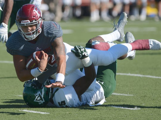 Florida Tech quarterback Mark Cato is brought down by Delta State safety Devontae Wilson last season.