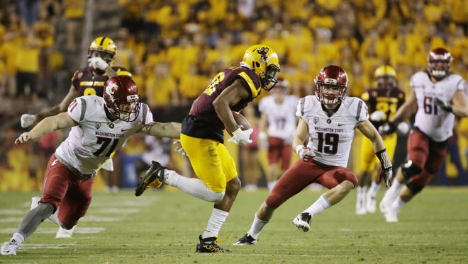 Arizona State wide receiver Tim White returns a punt for a touchdown against Washington State during PAC-12 action on Saturday, Oct. 22, 2016 in Tempe, Ariz.