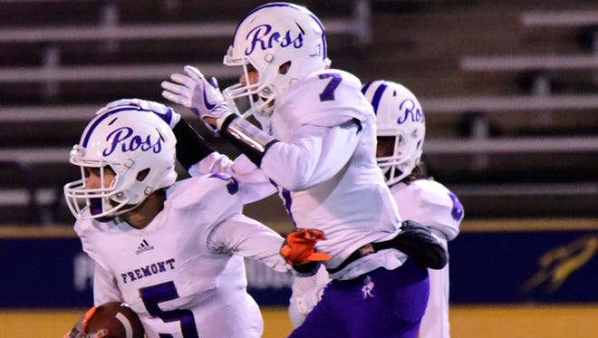 Roger Burling, left, had two interceptions and caught a touchdown pass for Fremont Ross last week.