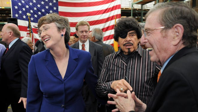 "In this March 7, 2011, file photo, Al Hurricane, center, looks on as former New Mexico Senator Pete Domenici, right, joins former U.S. Rep. Heather Wilson, R-N.M., left, at an event in Albuquerque, N.M. Hurricane, known as the ""Godfather of New Mexico music"" for developing a distinct sound bridging the state's unique Hispanic traditions with country and rock, has died. Hurricane died Sunday, Oct. 22, 2017, from complications related to prostate cancer. He was 81."
