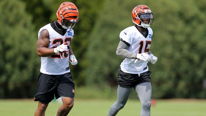 Cincinnati Bengals running back Joe Mixon (28) and  wide receiver John Ross have had excellent training camps thus far.