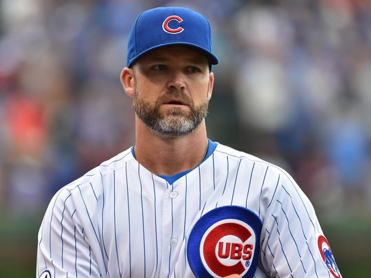 Chicago Cubs catcher David Ross before the game between the Chicago Cubs and the St. Louis Cardinals at Wrigley Field last September.