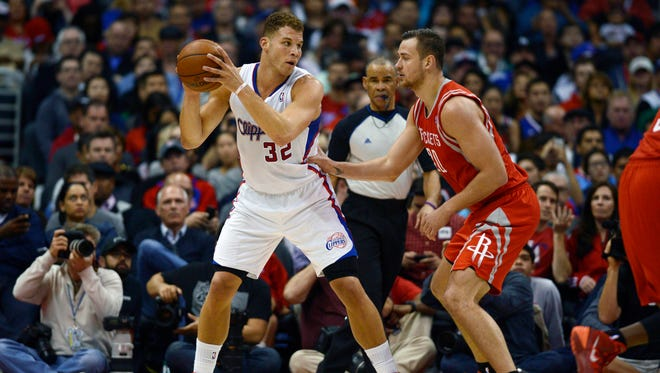 Los Angeles Clippers forward Blake Griffin (32) posts up against Houston Rockets forward Donatas Motiejunas (20).