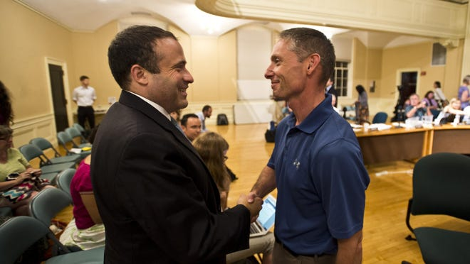 New York Police Department Deputy Inspector Brandon del Pozo greets former Burlington Police Chief Michael Schirling after the City Council appointed del Pozo as the city's new police chief Monday night.