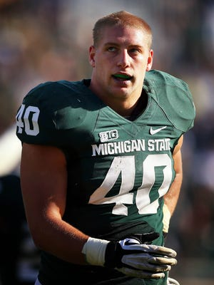 Michigan State linebacker Max Bullough (40) walks off the field after a game against the Northwestern Wildcats at Spartan Stadium.