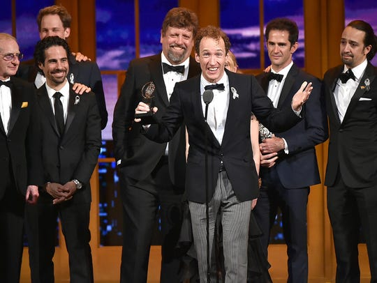 """Producer Jeffrey Seller (center) accepts the Tony award for Best Musical for """"Hamilton"""" onstage with his cast and creative team during the 70th Annual Tony Awards at The Beacon Theatre on June 12, 2016, in New York City."""