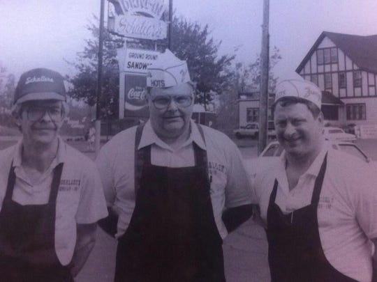 From left, Dave Burton, Jim Reisinger and Ray Schaller pose outside the restaurant in this circa 1991 photo.