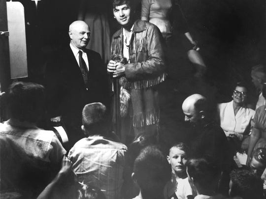 """Clad in buckskins, 'Davy Crockett' actor Fess Parker is greeted by Mayor George Dempster May 30, 1955 at Knoxville's Municipal Airport. The News Sentinel reported Parker was much impressed with the mayor's jokes. """"The acting profession lost a fine comedian when Mayor Dempster decided to make money instead of movies,"""" he said.(KNS Archive)"""