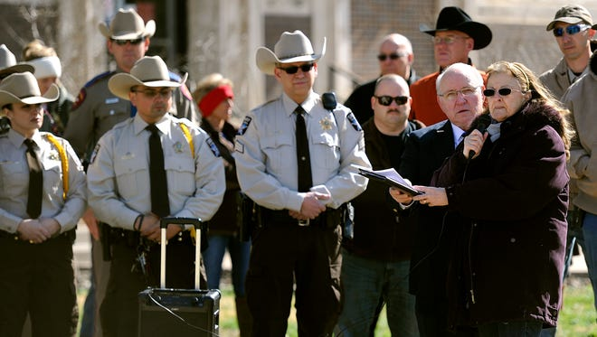Taylor County Sheriff's Office chaplain Donna Kleman announces the campaign to build a memorial to honor fallen law enforcement officers on Thursday, Feb. 2, 2017, at the Old Taylor County Courthouse.
