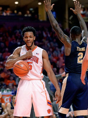 Clemson forward Jaron Blossomgame (5) reacts after being fouled by Pitt forward Michael Young (2) while scoring during the 1st half Wednesday, January 27,  2016 at Bon Secours Wellness Arena in downtown Greenville.
