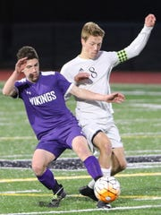 Klahowya's Drew Dickson (right) tangles with a North Kitsap defender during a recent match against the Vikings.