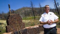Apache County Sheriff Joseph Dedman, Jr., stands near