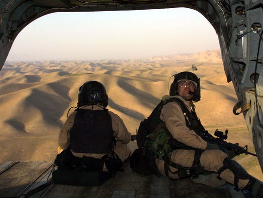 U.S. special operations soldiers keep watch from a