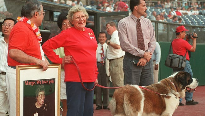 Marge Schott with one of her beloved St. Bernards.