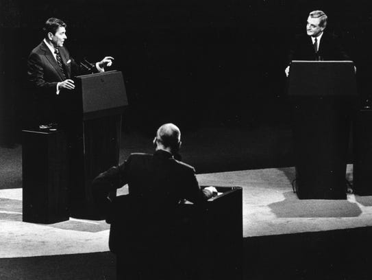 President Reagan, left, and Walter Mondale take part