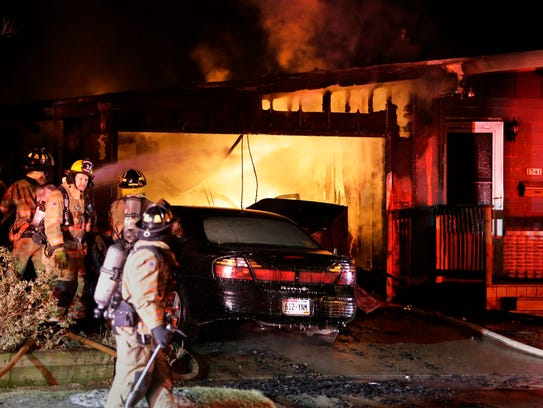 A scene from a house fire at 1541 North Avenue, Friday,