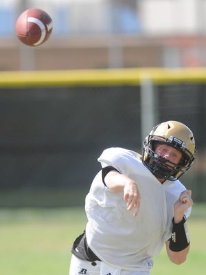 Abilene High quarterback Andrew Ezzell throws a pass during the Eagles practice Tuesday, May 16, 2017 at Abilene High.