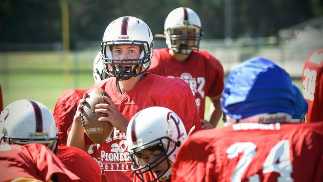 Pierz quarterback Preston Rocheleau drops back to pass Wednesday, Aug. 23, during practice.