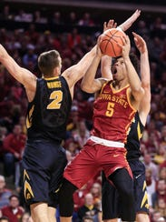 Iowa State guard Lindell Wigginton (5) drives against