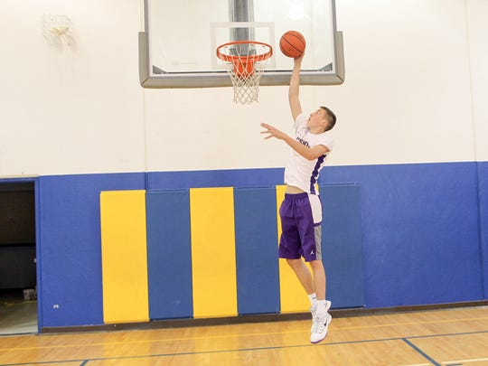 Muscatine's Joe Wieskamp goes up for a dunk at the West Middle School gym in Muscatine on Thursday, July 2, 2015.