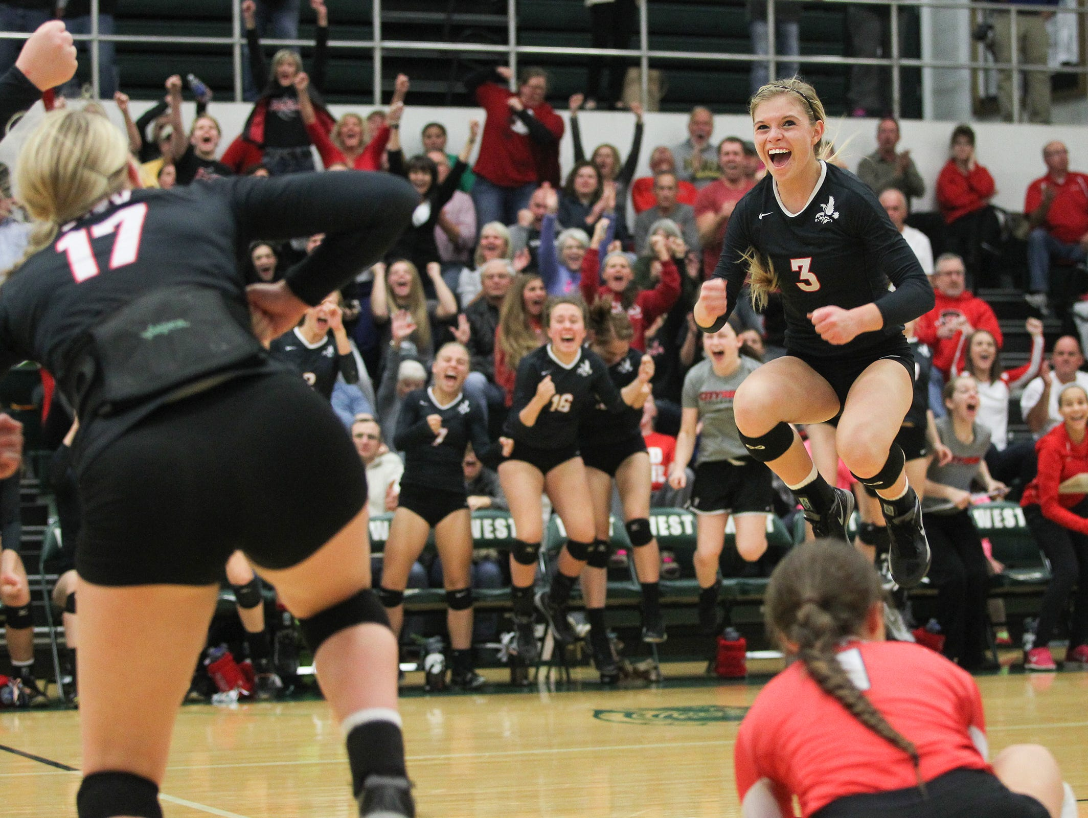 City High's Alexa Aldrich-Ingram celebrates a point during the Little Hawks' regional semifinal game at West High on Thursday, Oct. 29, 2015.