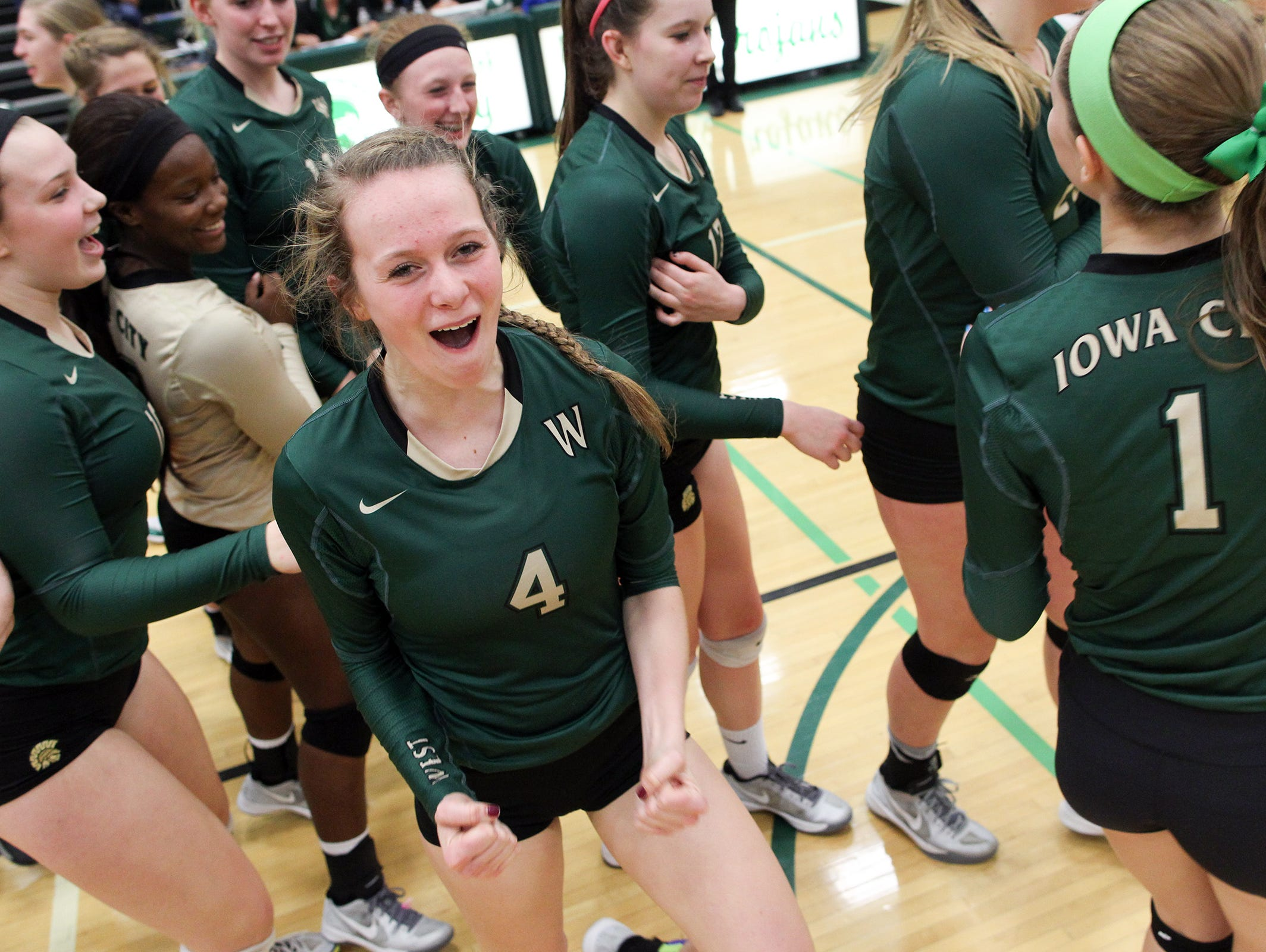 West High's Madi Ford celebrates the Women of Troy's regional semifinal win over City High at West High on Thursday, Oct. 29, 2015.