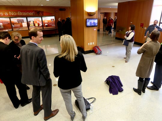 People watch an informational hearing of the House Committee On Human Services and Housing outside the hearing room on the first day of the Oregon Legislature short session at the State Capitol in Salem on Monday, Feb. 1, 2016.