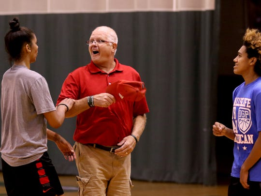 Price Johnson, the owner and operator of The Hoop, a competitive basketball training facility, laughs with players Evina Westbrook and Jaden Nielsen-Skinner during an after-school training session in Salem on Wednesday, Sept. 7, 2016.