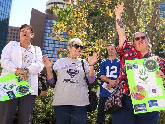 From left, registered nurses Anita Martin, Colleen Larivee and Jeanetta Bolser are recognized and called to speak during a rally outside the Indiana Statehouse held by IndyCann and the Higher Fellowship to advocate medical cannabis law reform, Indianapolis, Saturday, Sept. 30, 2017.