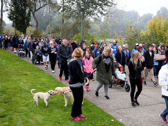 Thousands walk during the Out of the Darkness walk for suicide prevention and awareness at Riverfront Park in Salem on Oct. 14, 2017.