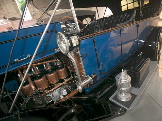 A 1912 Cadillac Touring, the first of its kind to have an electric self-starter, is in the collection of the GM Heritage Center. In 1912, Cadillac won the Dewar trophy for the electric starter and electric lights.