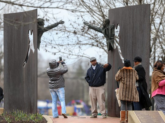 People visit the Landmark for Peace Memorial in Kennedy-King Park in Indianapolis.