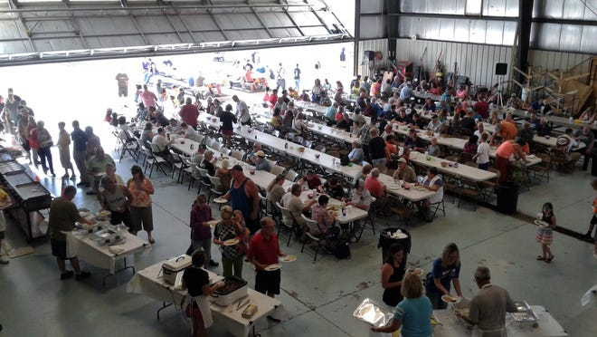 Crowds enjoying the Father's Day Fly-in/Drive-in Breakfast in a Marshall County Airport hangar are a long-running tradition, as shown here last year. But the annual event has been canceled this year because of the coronavirus.