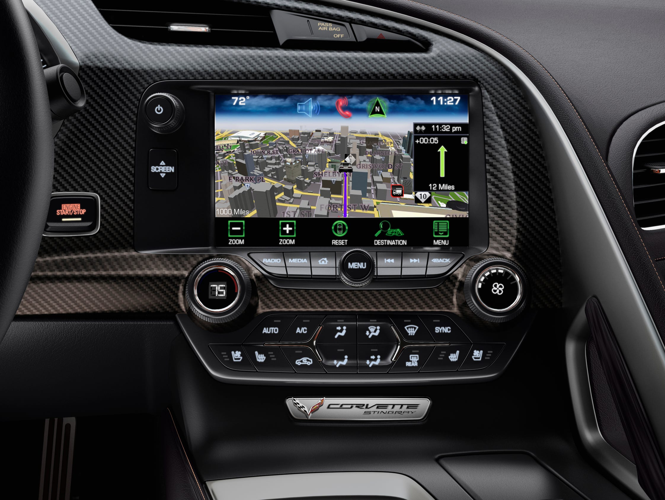 A separate large screen handles the 2014 Chevrolet Corvette Stingray's infotainment and control functions in the driver-centri cockpit.