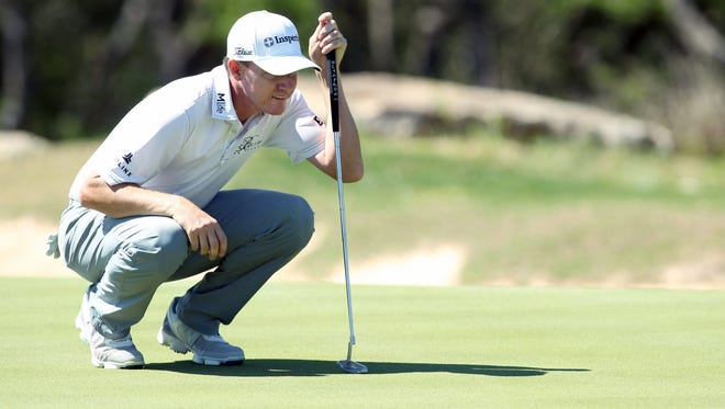 Jimmy Walker lines up a birdie putt on the sixth hole during the second round at TPC San Antonio - AT&T Oaks Course.