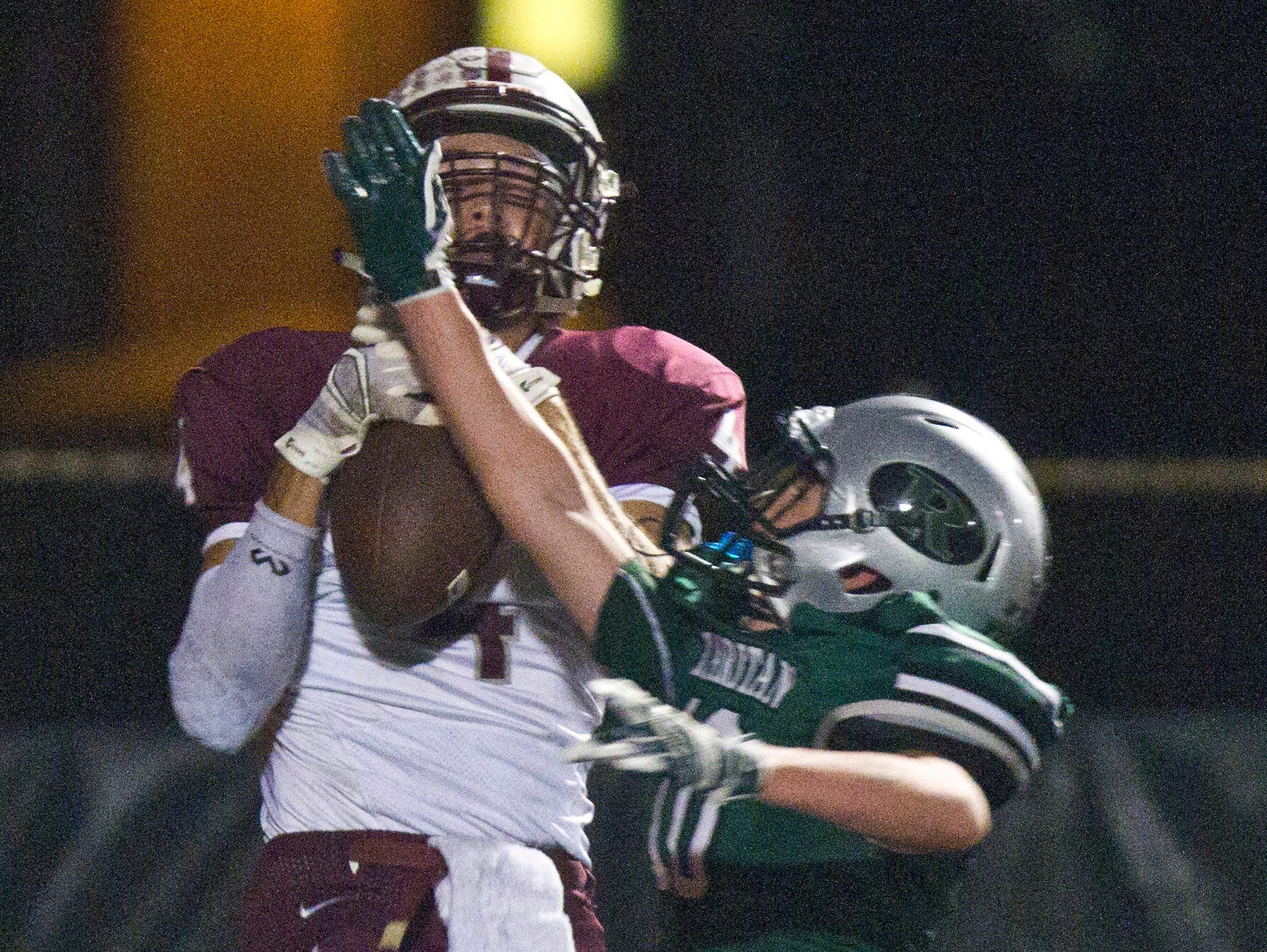 Red Bank Regional's Matt Reardon catches a touchdown pass with Raritan's Rory Sullivan's attempt to block the pass during the football game at Raritan High School in Hazlet, NJ Friday October 9, 2015.