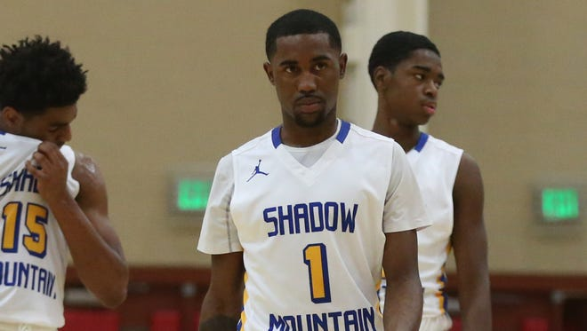Shadow Mountain's Jovan Blacksher's (1) defense helped force Pinnacle star Nico Mannion into missing eight 3-pointers.