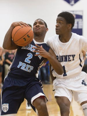 Ranney's Bryan  Antoine closely guards Mater Dei's  Nyquan McCombs during first half action in Mater Dei Prep Boys Basketball vs Ranney School in Tinton Falls, NJ on January 12, 2016.