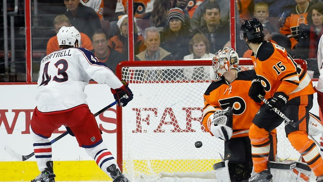 Scott Hartnell potted a goal to go with his two assists against the Flyers a night after he got benched.