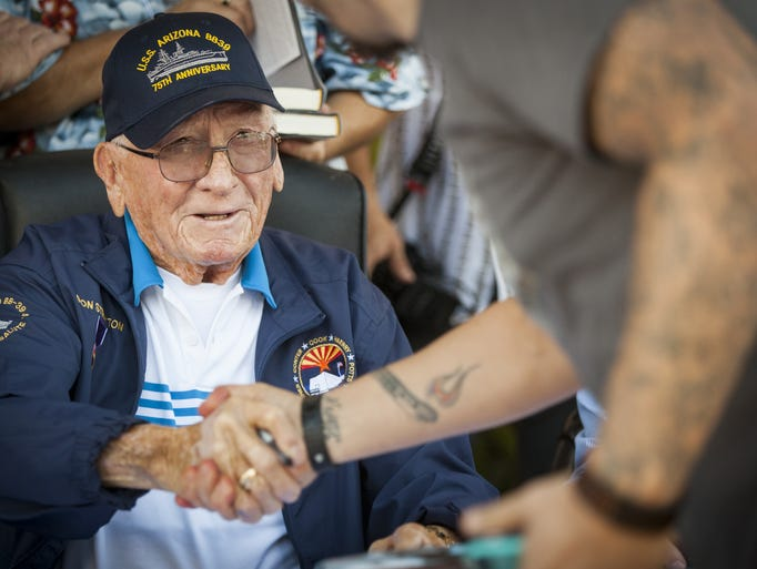 USS Arizona survivor Donald Stratton shakes hands with