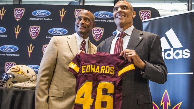 Arizona State University Vice President of University Athletics Ray Anderson, left, introduced the new head football coach Herman Edwards at Sun Devil Stadium, Monday December 4, 2017.