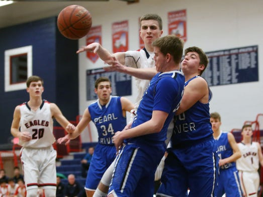 Eastchester and Pearl River in boys basketball action