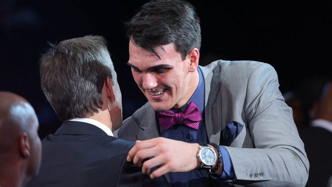 Dario Saric gets a hug after being selected as the number twelve overall pick at the Barclays Center.