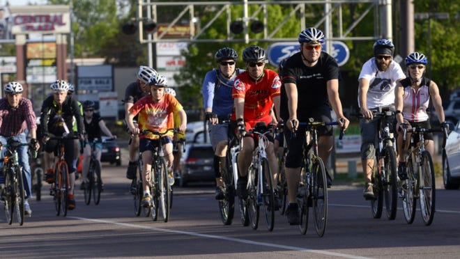 Cyclists on Minnesota Avenue during the 2014 Ride of Silence.