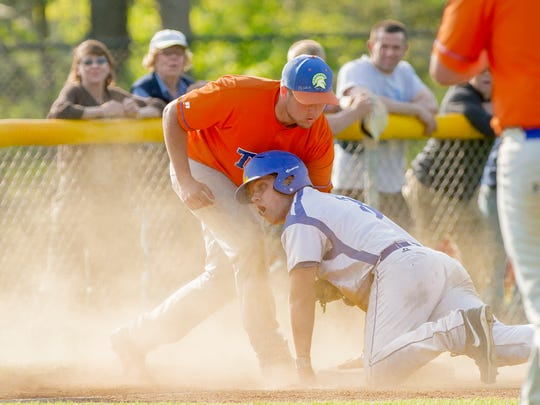Jesse Richardson, Lansing's leadoff hitter in the fifth inning, is called safe at third after hitting the ball deep into the outfield, despite the efforts of Edison's Josh Blunt to tag him out.